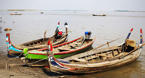 Fishermen boat on Ayeyarwaddy river in Myanmar Stock Photos