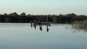 Fishermen on a boat stock video
