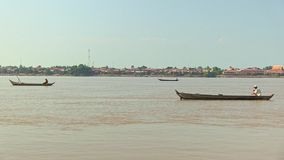 Fishermen on boat, fish boat, fishing boat, fisherman. Group of fishermen on boat fishing on mekong river stock footage