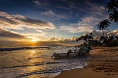 Fishermen and boat after fishing in Indian ocean Royalty Free Stock Photography