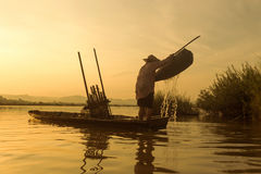 Fishermen on a boat fishing Stock Photo
