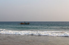 Fishermen in a boat floating in the Indian ocean Royalty Free Stock Photography