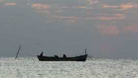 Fishermen boat before the sunrise. Fishermen boat floating before the sunrise, Full HD stock footage