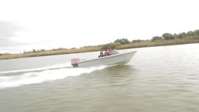 Fishermen in a boat stock video