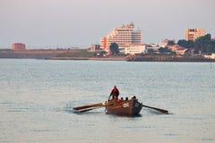 Fishermen boat near seashore Stock Photo