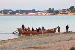 Fishermen boat near seashore Stock Images