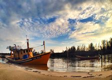 A fishermen boat nearby a beach waiting to go out to the sea. Fisherman boat nearby a beach Royalty Free Stock Image