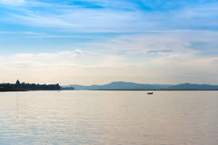 Fishermen in a boat on the river Irrawaddy in Mandalay, Myanmar, Burma. Copy space for text. Royalty Free Stock Photos