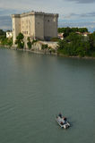 Fishermen in boat on river Rhone under castle Tarascon Stock Photo