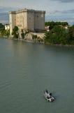 Fishermen in boat on river Rhone under castle Tarascon stock photo