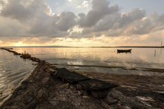 Fishermen Boat Sunset Lagoon Royalty Free Stock Photography
