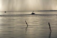 Fishermen Boat Sunset Lagoon Stock Photography