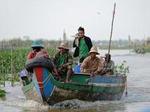 Fishermen in boat, Tonle Sap, Cambodia Royalty Free Stock Images