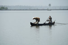 Fishermen in a boat Royalty Free Stock Image
