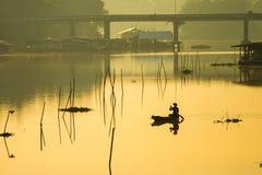 The fishermen are boating fishing in the morning on Sakae Krang Royalty Free Stock Photos