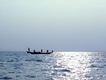 Fishermen boating on fresh morning background Stock Images