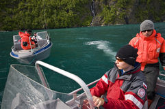 Fishermen in boats. Four fisherman traveling in motor boats on Norwegian fjord Stock Images