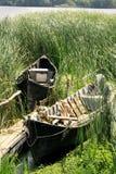 Fishermen boats. Old fishermen boats in the Danube Delta Stock Photos