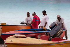 Fishermen with boats. Royalty Free Stock Photo