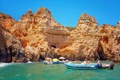 Fishermen in boats, Algarve, Portugal Royalty Free Stock Photos