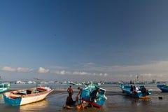 Fishermen boats  along a beach shore, Puerto Lopez Stock Photos