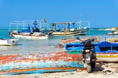 Fishermen in Boats on the Shore of the Mediterranean Sea in Djerba, Tunisia royalty free stock photo