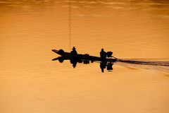 Fishermen on boats. With sunrise silhouette in Ubon Ratchathani Stock Photography