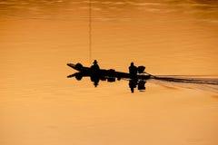 Fishermen on boats Stock Photography