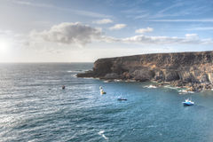 Fishermen boats at sunset time. Panoramic view of a cliff at sunset , with several fishermen boats Stock Photo
