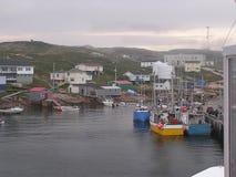 Fishermen boats and village. Fishermen village on coastline of St Laurence River, Harrington Harbour, Quebec Stock Image