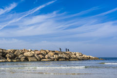 Fishermen on breaker Royalty Free Stock Image