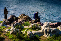 Fishermen In A Bright Day Royalty Free Stock Photo