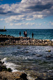 Fishermen In A Bright Windy Day. People on fishing in a bright but windy weather condition. Locals of the Cinarcik Town the district of Yalova City are most Stock Image