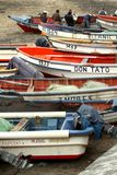 Fishermen bussy inspecting their boats royalty free stock photos