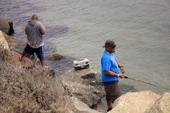 Fishermen in California. Morro Bay, USA - 30 August 2016 - men fishing Royalty Free Stock Images