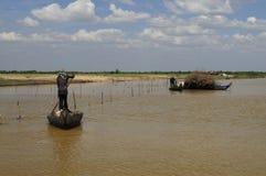 Fishermen on canoes in Tonle Sap lake, Cambodia. stock image