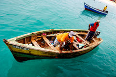 Fishermen in Cape Verde. SANTA MARIA, CAPE VERDE - DECEMBER 15, 2015: Fishermen returning home after catching the tuna fish Stock Photography
