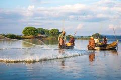 Fishermen catch fish Royalty Free Stock Photo