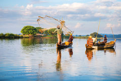 Fishermen catch fish December 3, 2013 in Mandalay. Stock Photo
