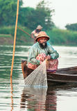 Fishermen catch fish December 3 Royalty Free Stock Photography