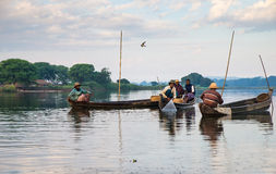 Fishermen catch fish December 3, 2013 in Mandalay Royalty Free Stock Photo