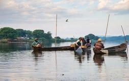 Fishermen catch fish December 3, 2013 in Mandalay Royalty Free Stock Photo