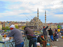 Fishermen catch fish on the Galata Bridge Royalty Free Stock Photo
