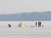 Fishermen catch fish on ice Royalty Free Stock Photos