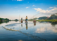 Fishermen catch fish Royalty Free Stock Image