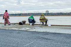 Fishermen catch fish on the pier. Of the Baltic sea Royalty Free Stock Photo