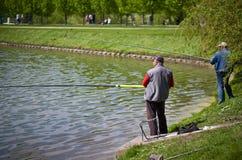 Fishermen catch fish. Stock Photos