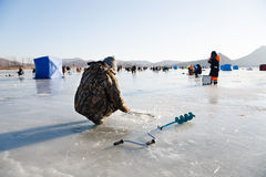 Fishermen catch smelt in the winter on the river, Russia Royalty Free Stock Image