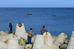 Fishermen catch a sprat in the Baltic Sea in sunny spring day Royalty Free Stock Photography