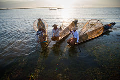 Fishermen catches fish for food in sunrise in Inle lake Stock Photos